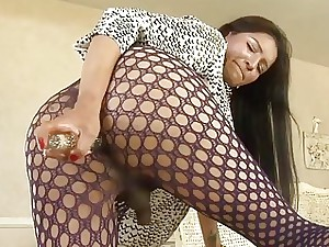 She-male In Stockings Pulverizes Herself With A Faux trunk