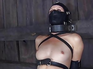 Ball-gagged and strapped up girl gets her pearls satisfied