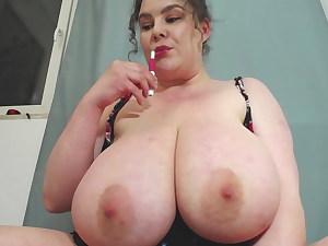 Chubby girl shakes her gigantic orbs on cam