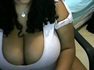 Big ebony tits played with