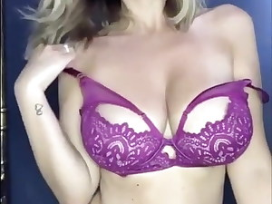 Blonde With Ginormous Boobs Takes off Her Bra