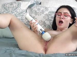 Solo darling masturbates using a huge white dildo